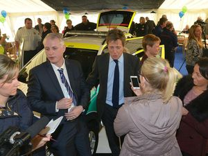CANNOCK STEVE LEATH COPYRIGHT EXPRESS AND STAR 02/05/2014  Hugh Grant at Buntwood Rugy Club at Community First Responders Car launch.  On the left of Hugh is Paul Dadge (check spelling) friend of Hugh's..
