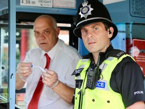 Safer Travel police officer Shaun Hickinbottom with a National Express West Midlands bus driver and a spit kit