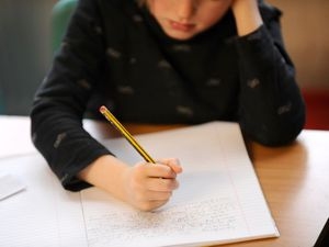 A primary school child doing some writing