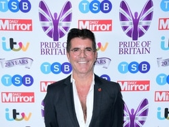 Simon Cowell in hospital after breaking back in bike fall