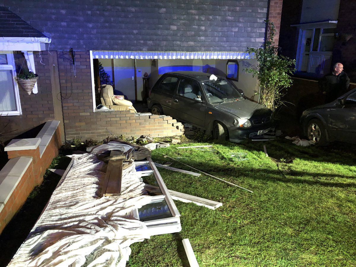 The car smashed into the house during the incident. Photo: @WMFSDudley