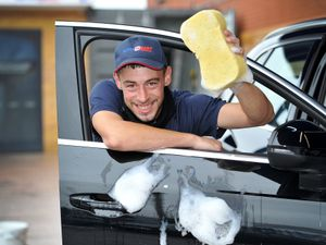 Top Gun Valeting staff member Lee Holmes is getting ready for their charity car wash