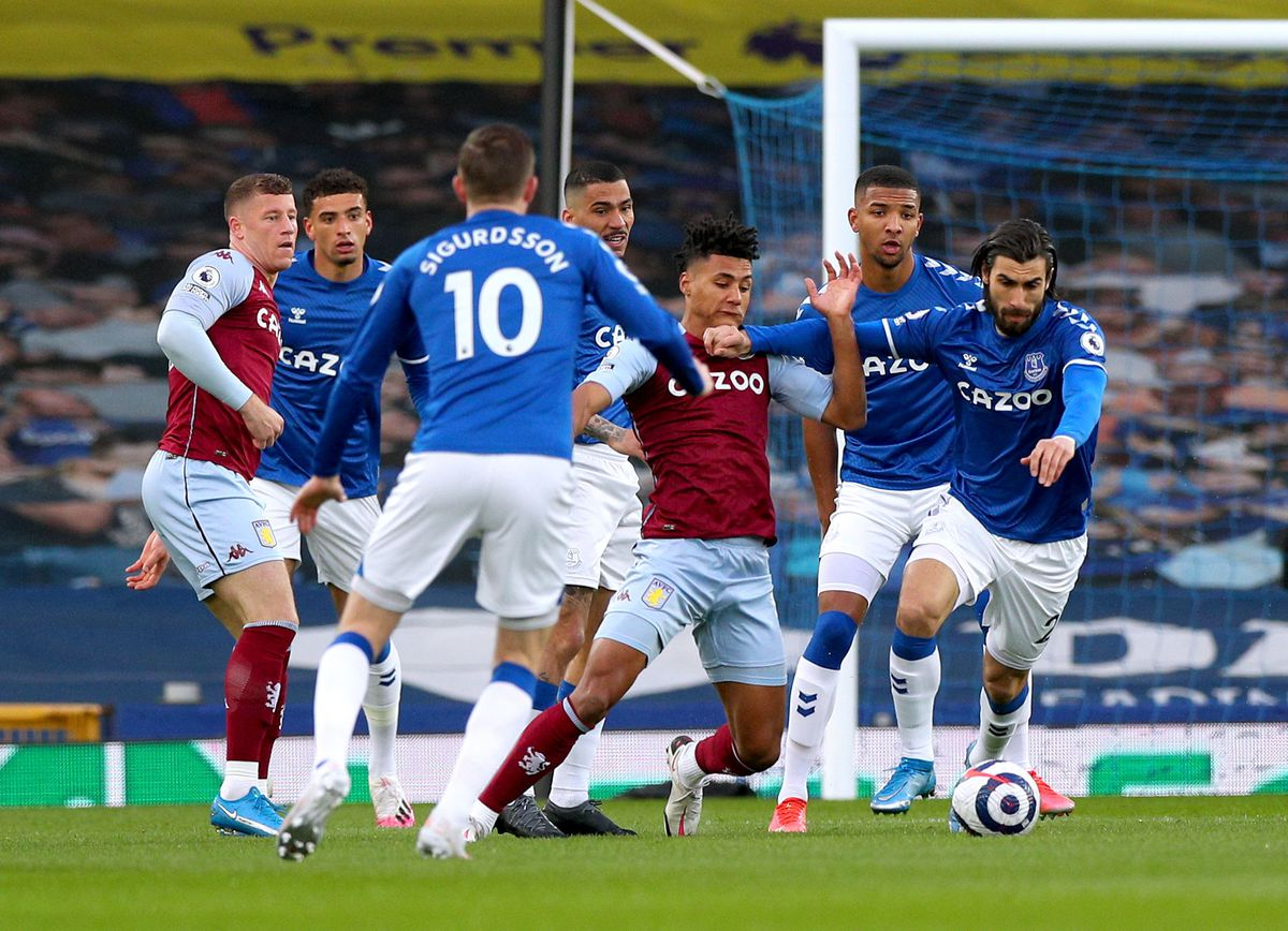 Everton's Andre Gomes (right) and Aston Villa's Ollie Watkins (centre) battle for the ball