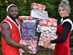 Daniel Jay Smith Jr and Councillor Beverley Momenabadi spent a day delivering presents to families across Wolverhampton