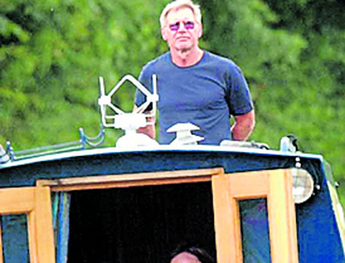 Harrison Ford at the helm of a narrowboat on the picturesque Llangollen Canal in Shropshire, in 2004