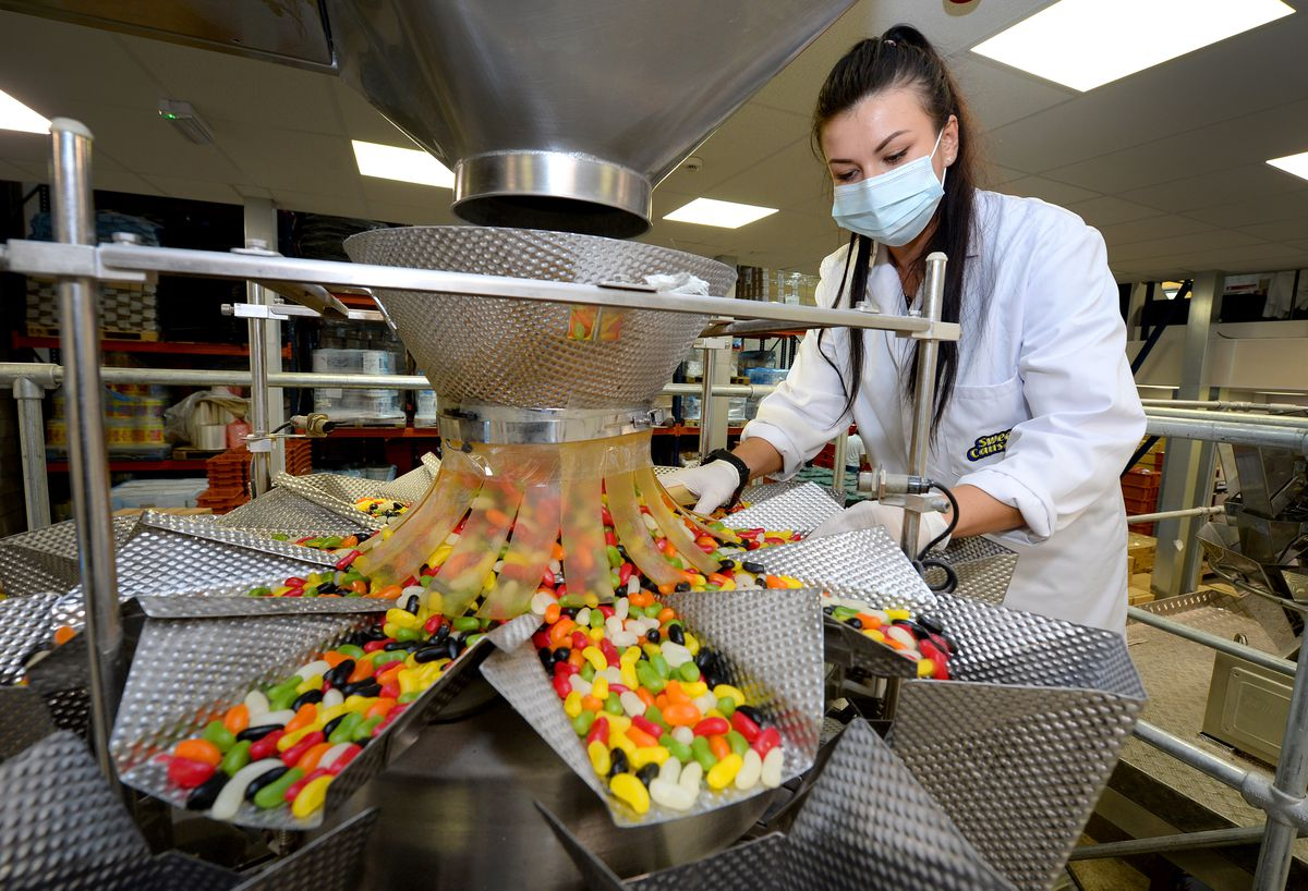 Anna Szymczyk checks on the sweets as they are packaged