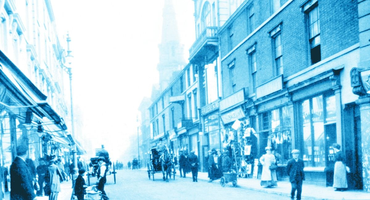 Queen Street contained a mixture of stores and older buildings