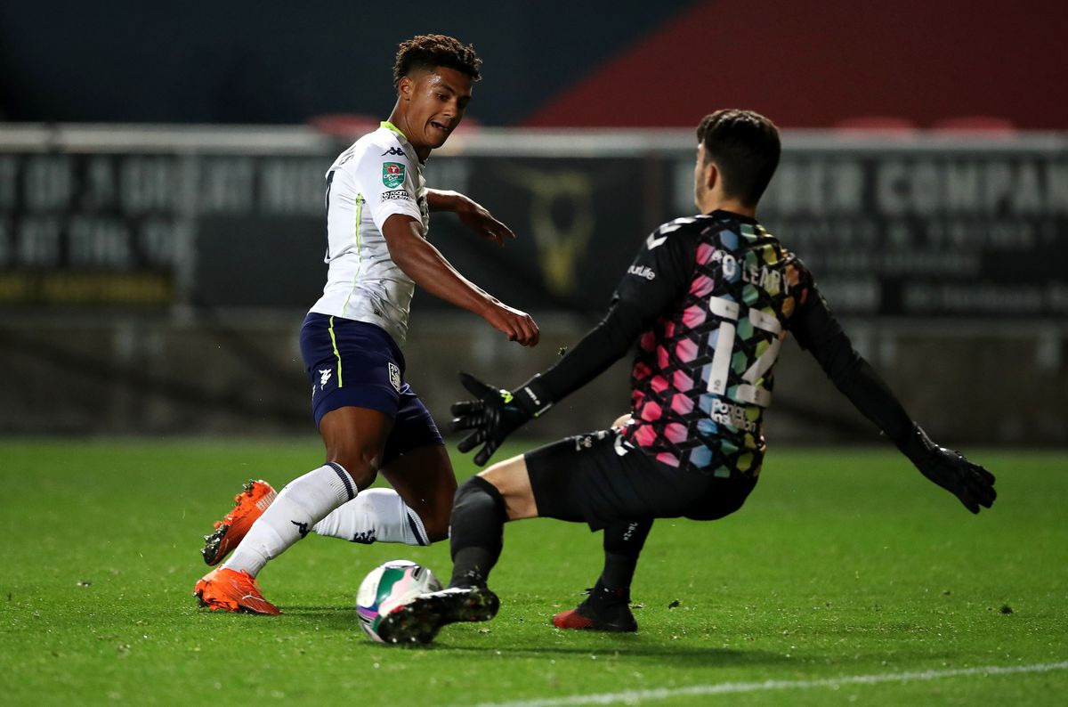 Aston Villa's Ollie Watkins (left) sees his shot saved by Bristol City goalkeeper Max O'Leary