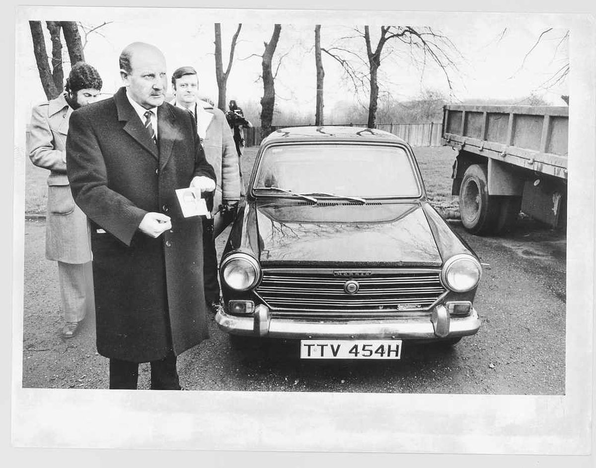 Detective Chief Superintendent Bob Booth by the Black Panther's stolen car.