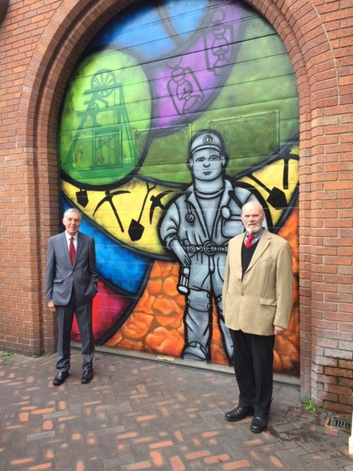 Councillor George Adamson, Leader of Cannock Chase Council with Councillor Gordon Alcott,Leader for Town Centre Regeneration viewing the newly transformed shutters in Cannock Town Centre.
