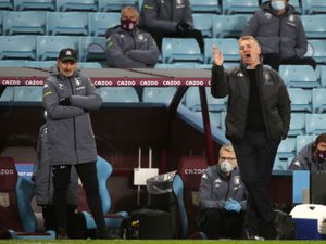Aston Villa manager Dean Smith (centre) and assistant manager Richard O'Kelly (left)