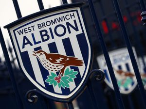 An West Bromwich Albion club crest on the gates at The Hawthorns. Photo: AMA