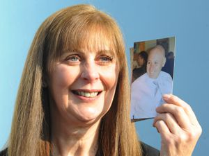 Margaret Kelsall with a photograph of her husband of 33 years