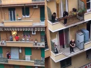People gather on their balconies in Rome to sing the national anthem during the coronavirus lockdown