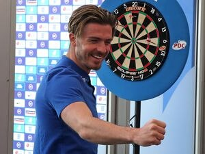 England's Jack Grealish celebrates after playing a game of darts during the press conference at St George's Park, Burton. Picture date: Wednesday June 9, 2021. PA Photo. See PA story SOCCER England. Photo credit should read: Nick Potts/PA Wire. .RESTRICTIONS: Use subject to FA restrictions. Editorial use only. Commercial use only with prior written consent of the FA. No editing except cropping..
