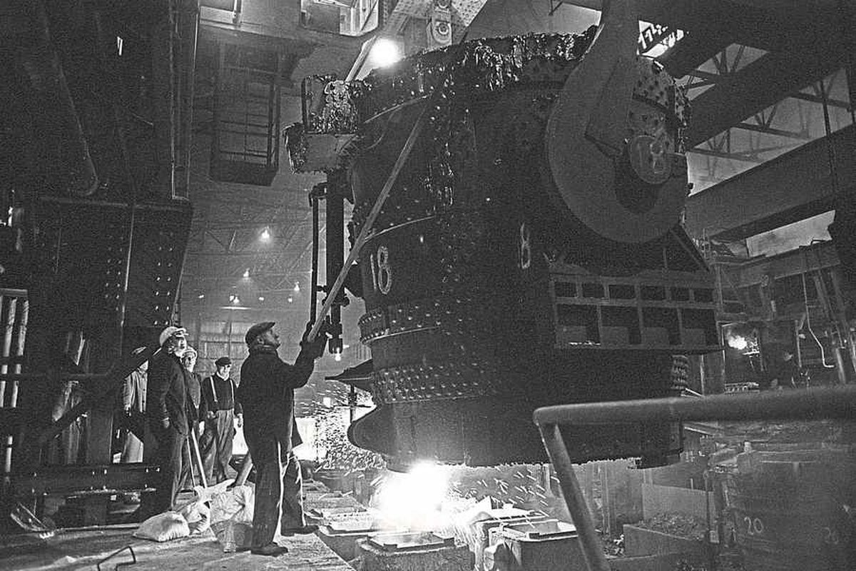 Molten steel is poured by workers at Bilston Steelworks by Nick Hedges