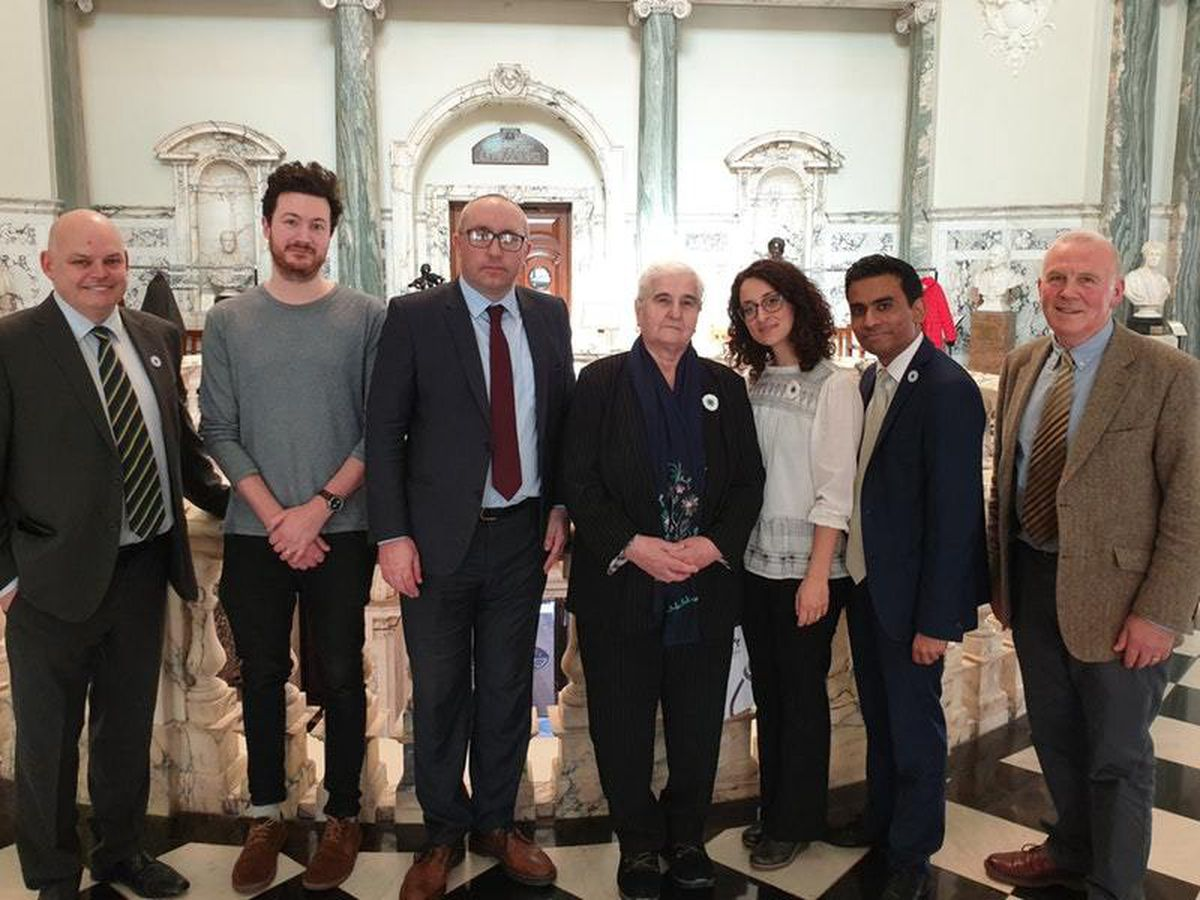 Remembering Srebrenica UK director Amil Khan, second right, and Munira Subasic, president of the Mothers of Srebrenica, centre, meeting Northern Ireland councillors