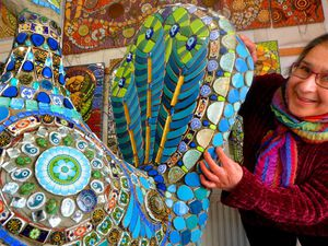 Caroline Jariwala, of Mango Mosaics, with a peacock sculpture