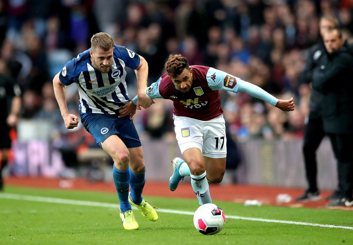 Aston Villa's Trezeguet (right) and Brighton and Hove Albion's Adam Webster (left) battle for the ball