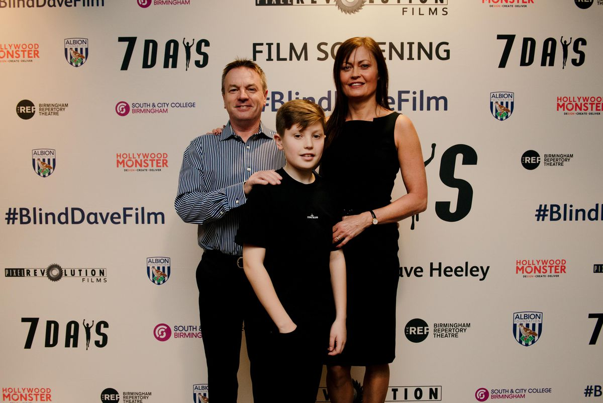 Charlie Bowell, centre, with parents Andy and Samantha