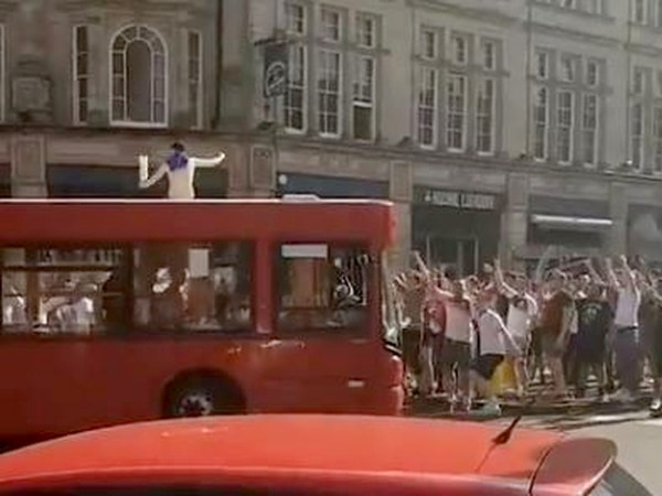 WATCH: England fan celebrates on top of a BUS in Wolverhampton city centre