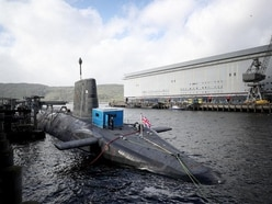 Peace campaigners stage rally at nuclear submarine base