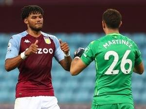 Aston Villa goalkeeper Emiliano Martinez and Tyrone Mings