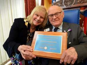 Dr Fraser Dukes receiving his distinguished service award from Rotary president of Great Britain and Ireland, Eve Conway