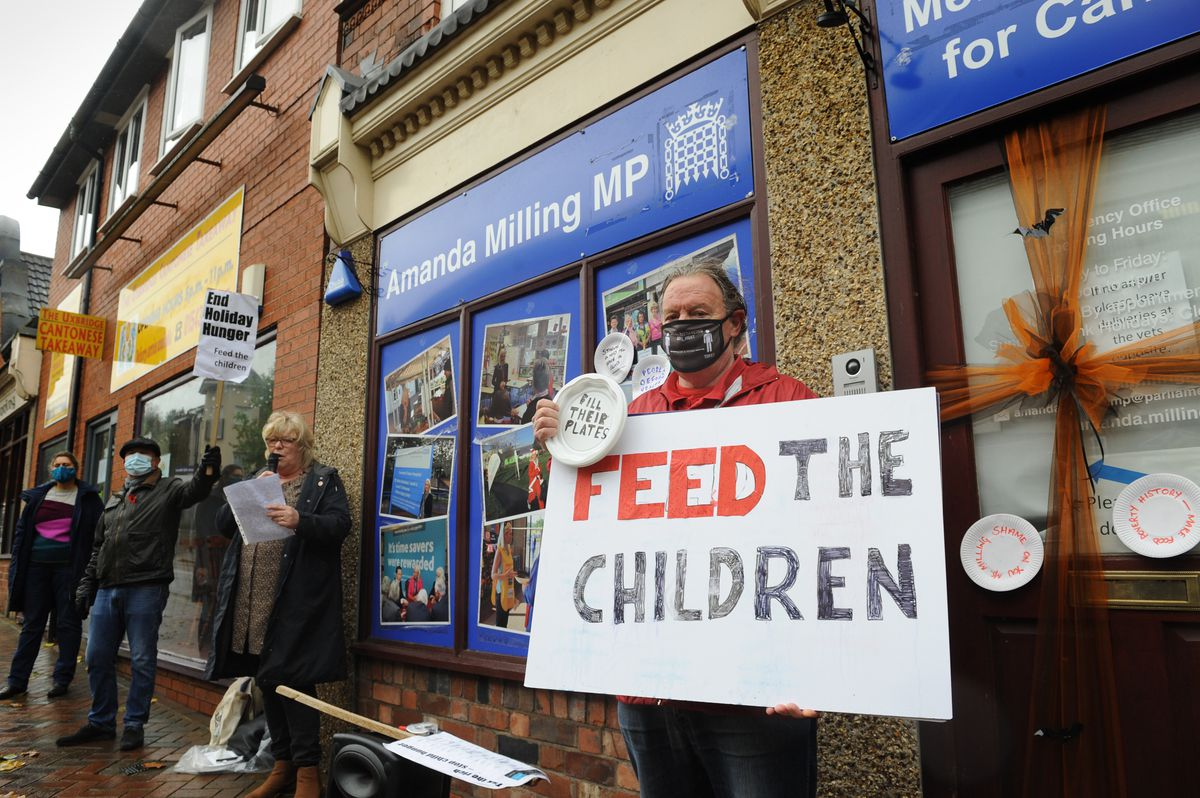 Protesters gathered outside the office of Amanda Milling office in Hednesford following the MP's vote against extending free meals