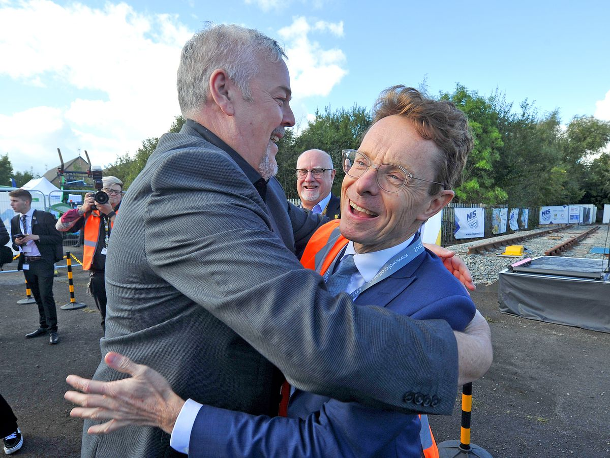 Wolverhampton Council leader Ian Brookfield embraces Andy Street, Mayor of the West Midlands, at the City of Wolverhampton College's Wellington Road campus