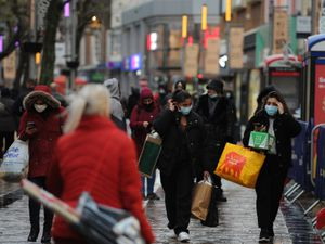 Shoppers brave the wet weather in Christmas week in Wolverhampton