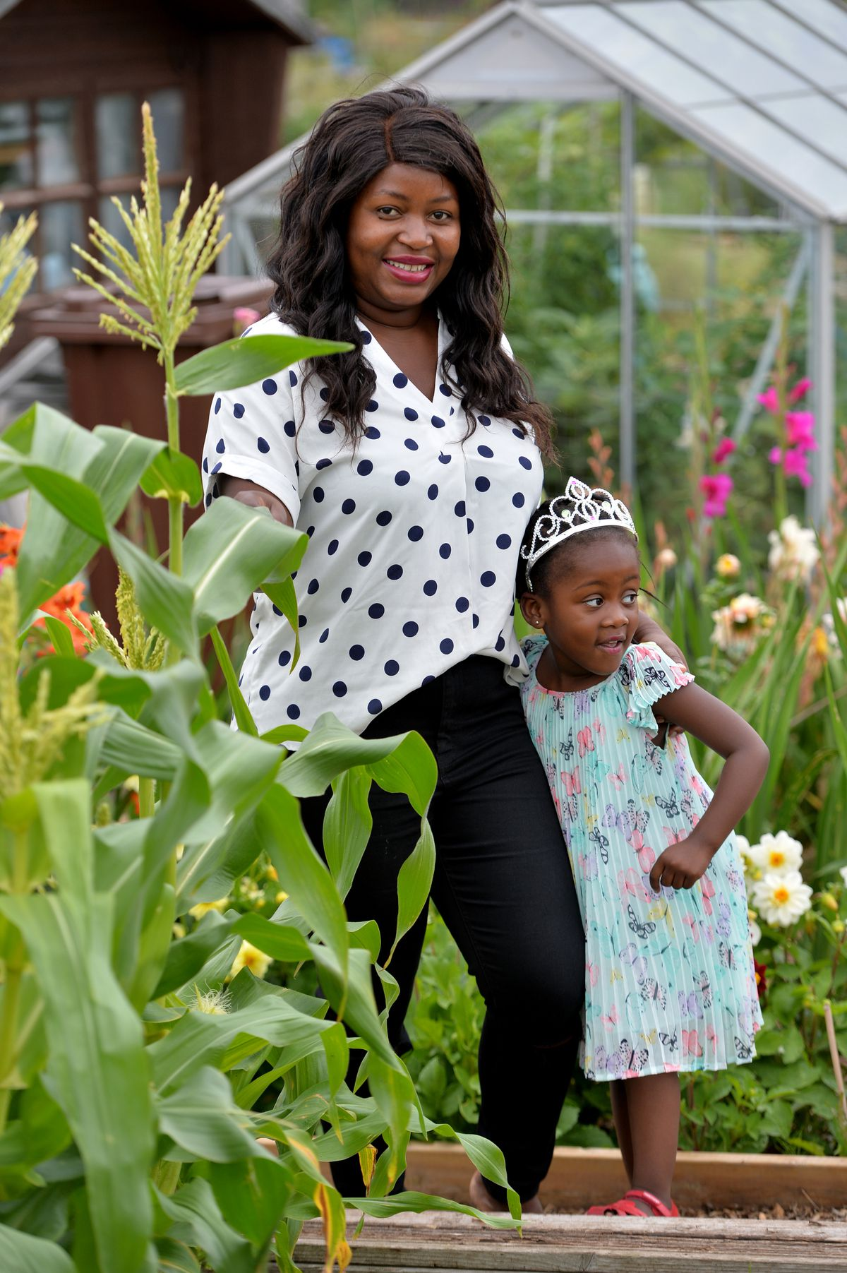 Zamile and her children enjoy time working on the allotments