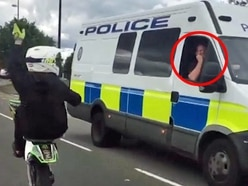 Police officer appears to swear at illegal rider