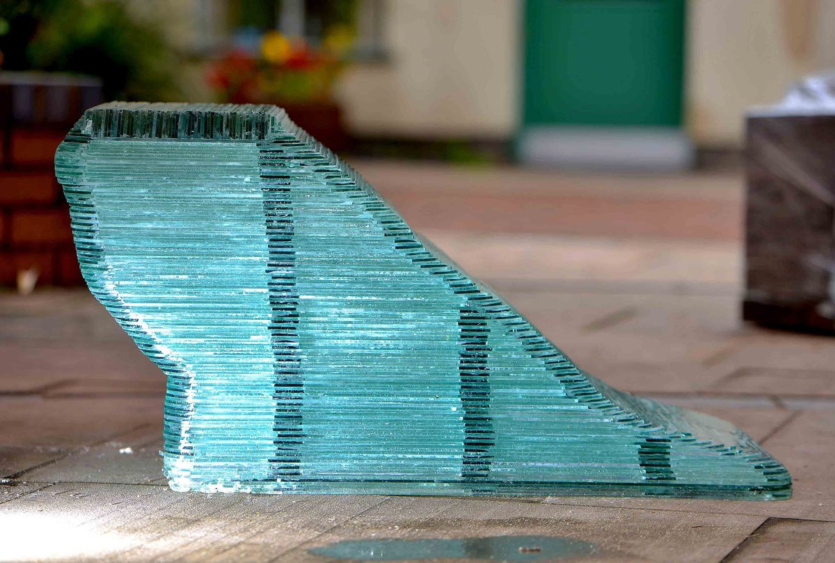 The piano stool is also made out of glass