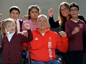 Paul Shaw, head coach of Team GB's gold medal-winning disability rugby team at this year's Tokyo Paralympics,with Ferndale Primary School students and headteacher Ruth Gillett