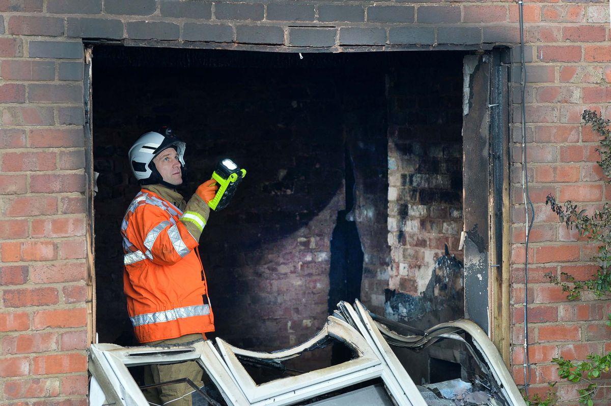 Fire investigators at the scene in Beacon Lane on Sunday