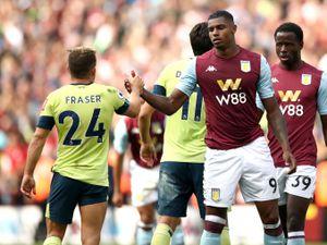 Aston Villa's Wesley (right)