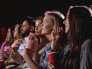 People watching a film together