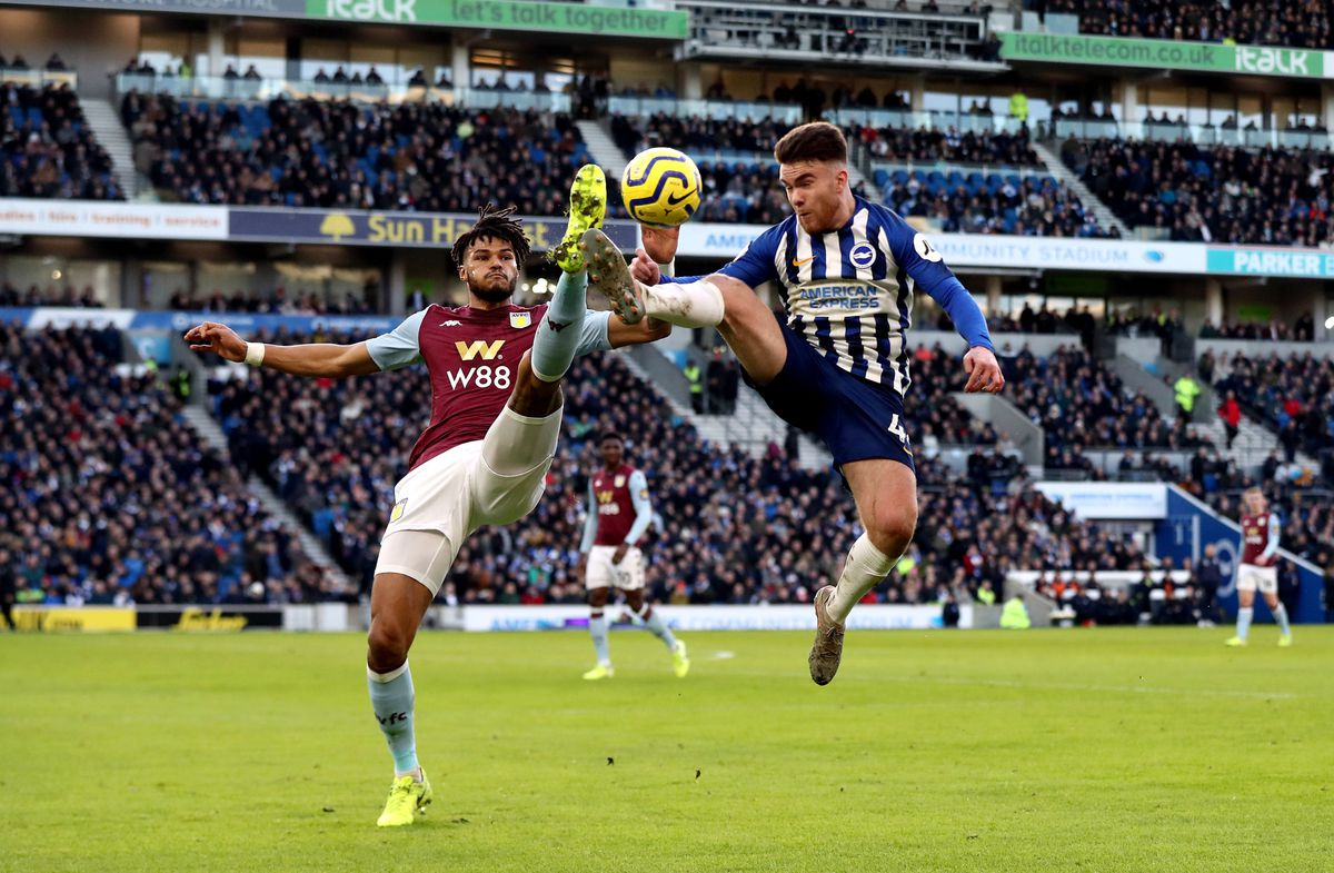 Tyrone Mings challenges Brighton's Aaron Connolly on Saturday.