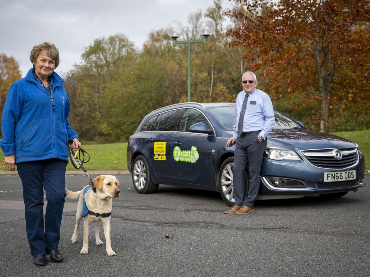 Volunteer Puppy Walker and Fundraiser, Sue Nicholas, Trainee Guide Dog, Maci and Go Carz Regional Director Graham Hoof