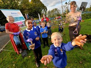 Bilston C of E Primary School and Councillor Beverley Momenabadi and Rotarian Elaine Hadley Howell. They were planting purple crocus bulbs as part of the Rotary project: Purple for Polio, and were also planting some fruit trees. Pupils front are Janiah Price, eight, and Luke Smith, four