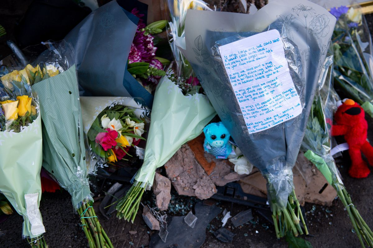 Flowers and messages left at the scene of the crash that killed two-week-old Ciaran Leigh Morris