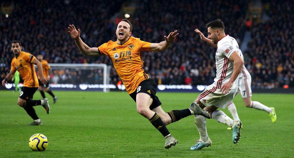 Wolverhampton Wanderers's Diogo Jota (centre) and Sheffield United's George Baldock