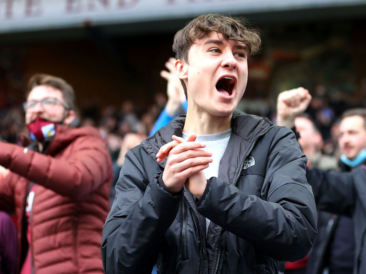 Aston Villa fans celebrate a strike against Chelsea in the first game at Villa Park after lockdown in May