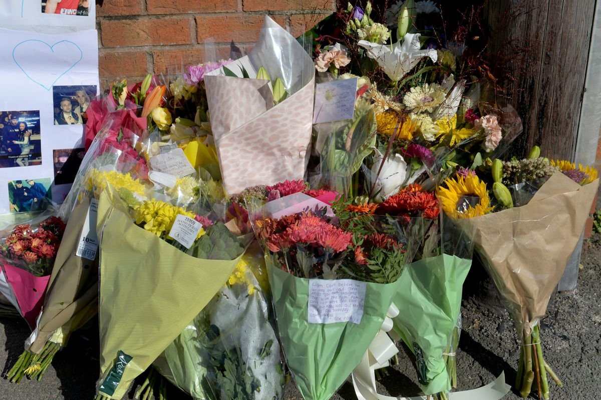 Some of the flowers left at the scene