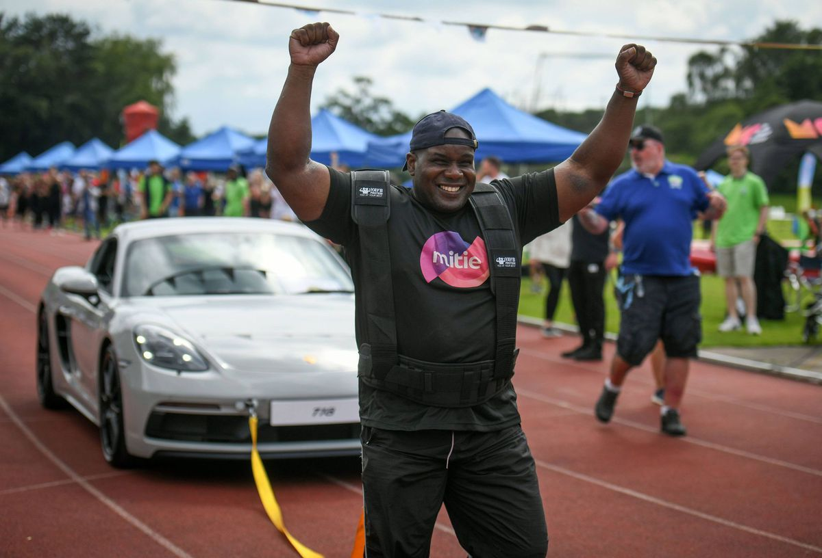 Discus thrower Kevin Brown took part in a porsche pull event