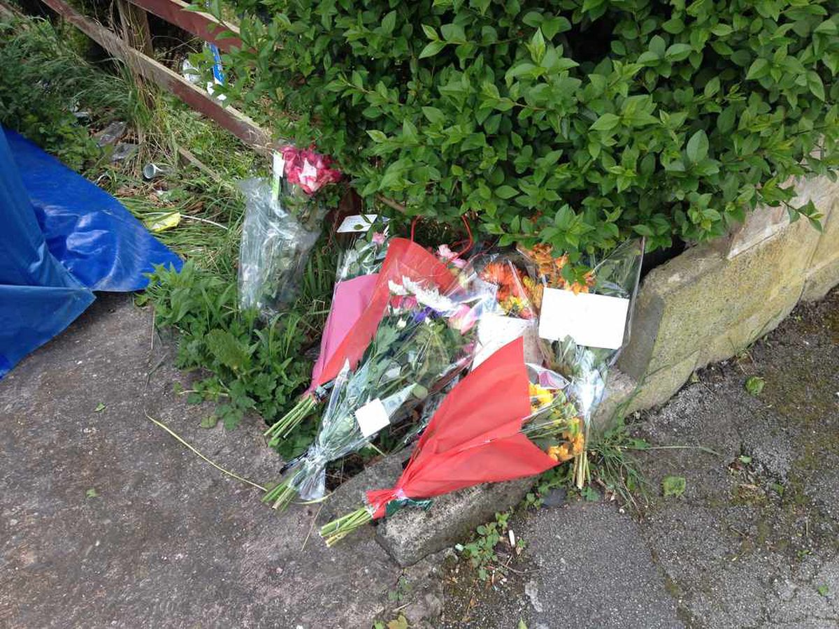Floral tributes left outside the family home.