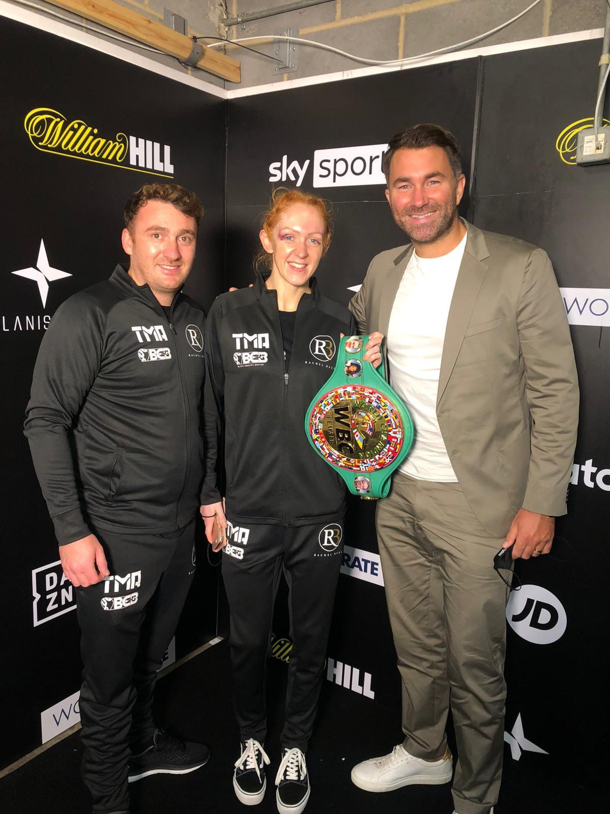 Aldridge Rachel Ball is all smiles with promoter supremo Eddie Hearn and coach Gav Burrows after claiming the WBC super-bantamweight title on points