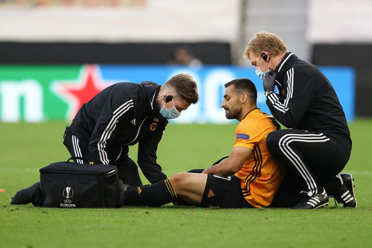 Jonny Otto of Wolverhampton Wanderers goes down injured (AMA)