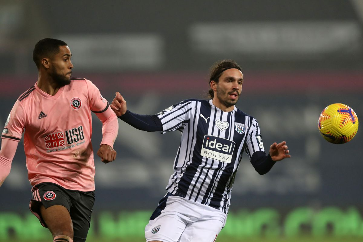 Max Lowe of Sheffield United and Filip Krovinovic of West Bromwich Albion. Pic: AMA.